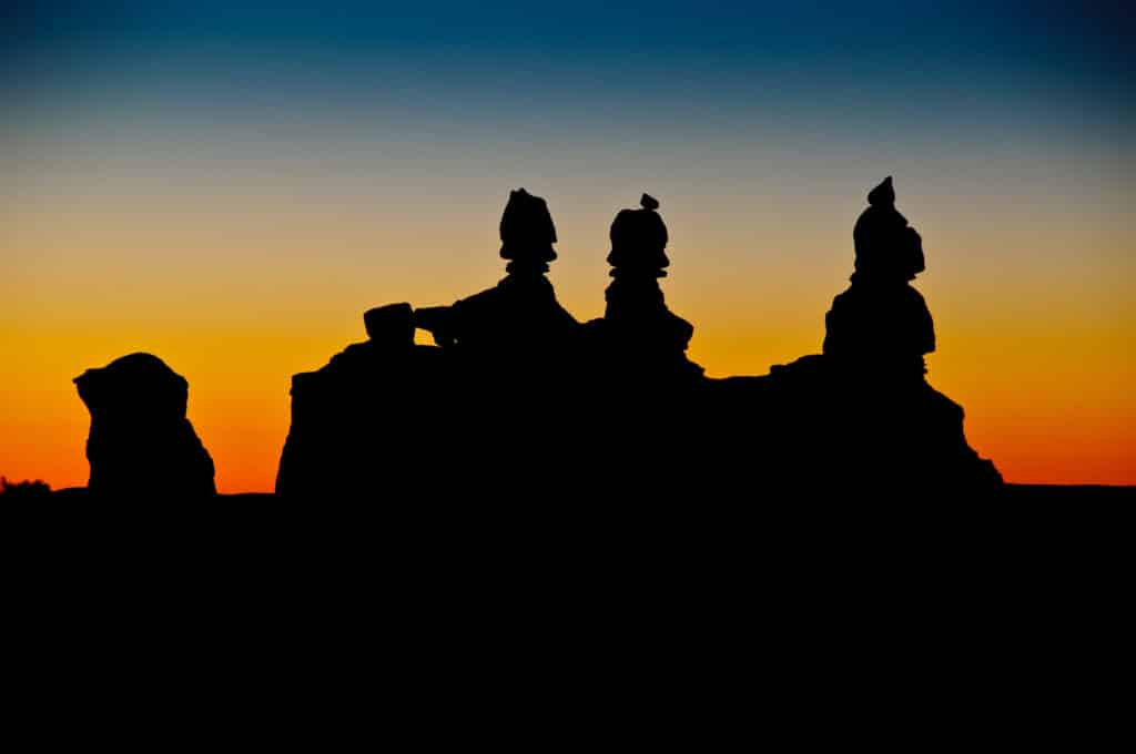 Twilight silhouettes of the rock feature known as The Judges in Goblin Valley.