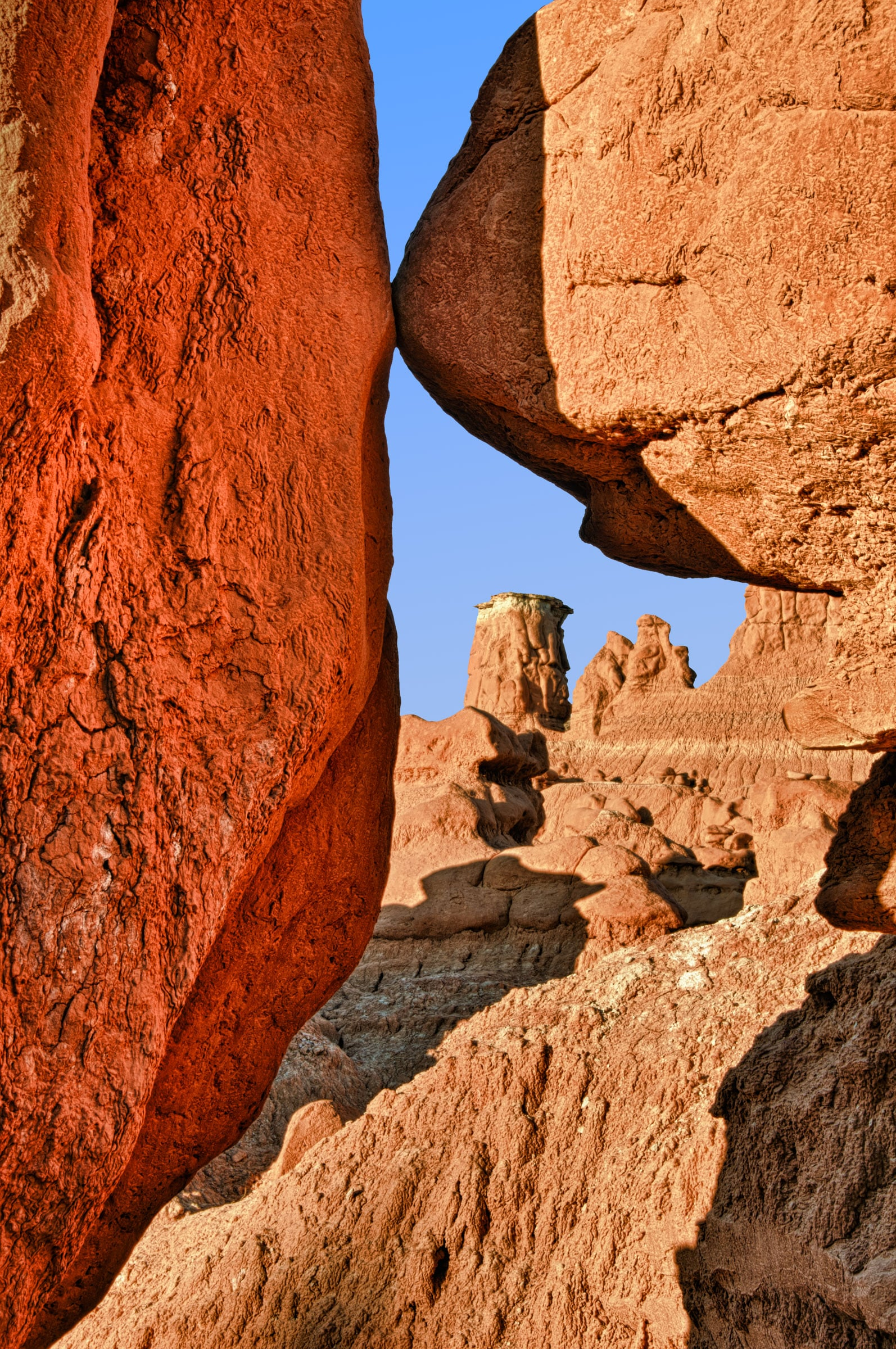A hoodoo in Goblin Valley State Park, Utah, is framed in the early morning light.