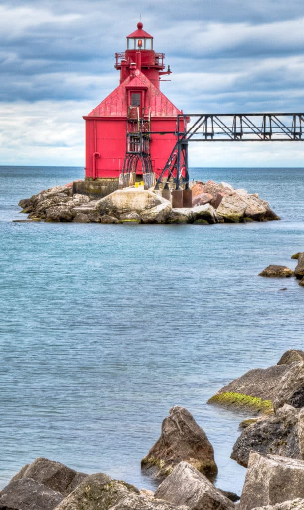 Traditional lighthouse at the end of a jetty at the Lake Michigan end of the Sturgeon Bay channel.