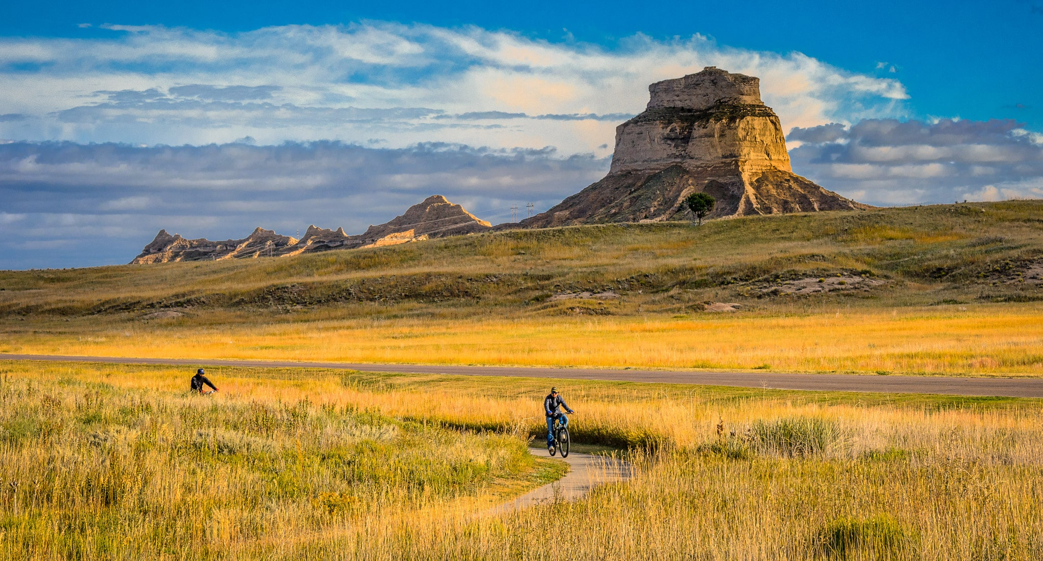 Two bicyclists enjoy the bike trails in Scotts Bluff National Monument in Nebraska.