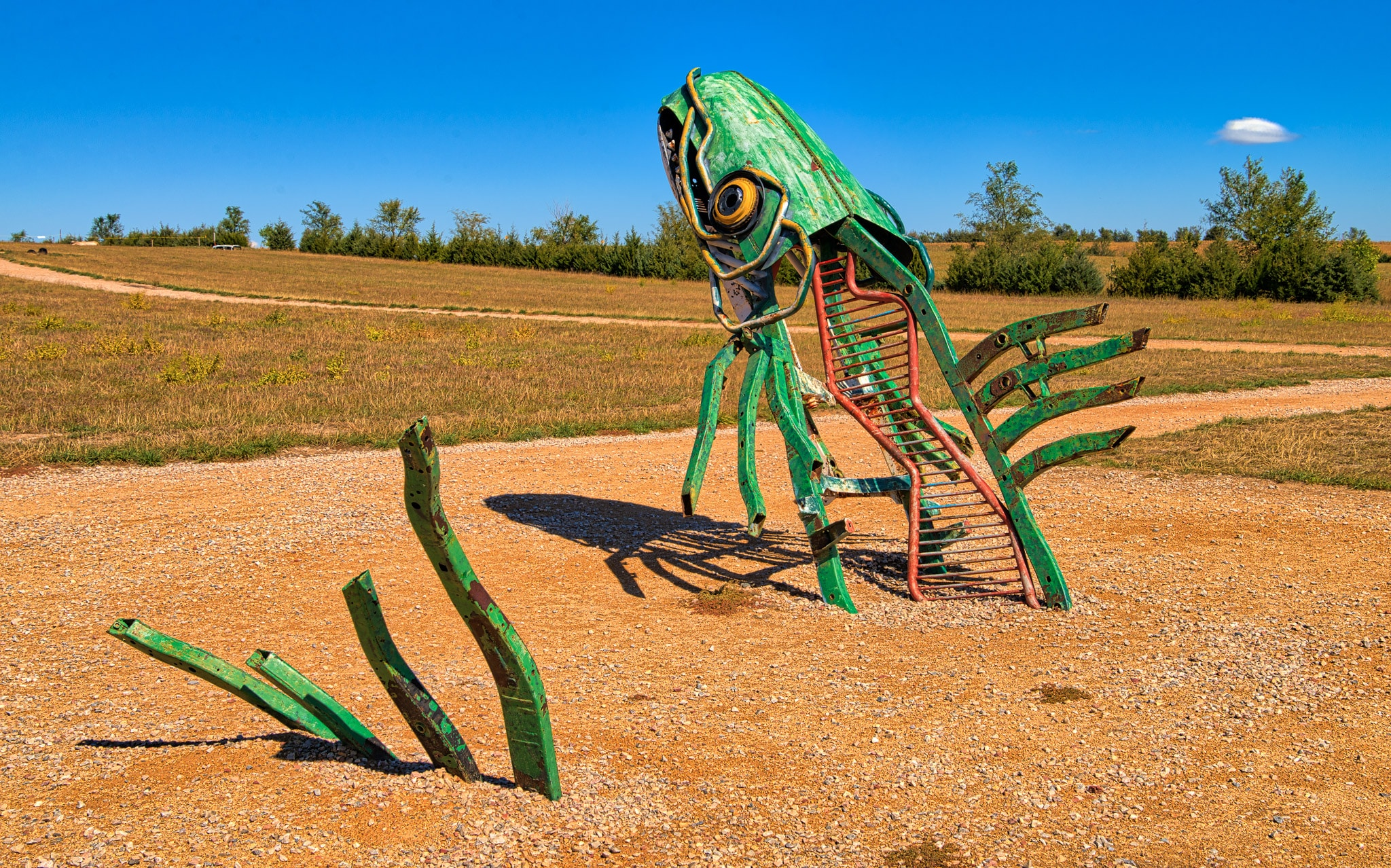 "At the quiky roadside attraction of Carhenge, near Alliance, Nebraska, are other scuptures made from automobile parts. This one is called ""Spawning Salmon"" and was created by Geoff Sandhurst."