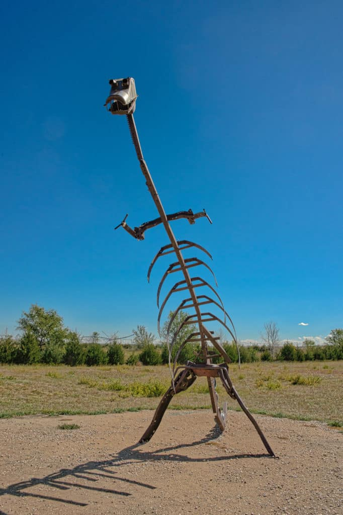 This dinosaur sculpture, made from automobile parts, is located at Carhenge, a roadside attraction outside of Alliance, Nebraska,