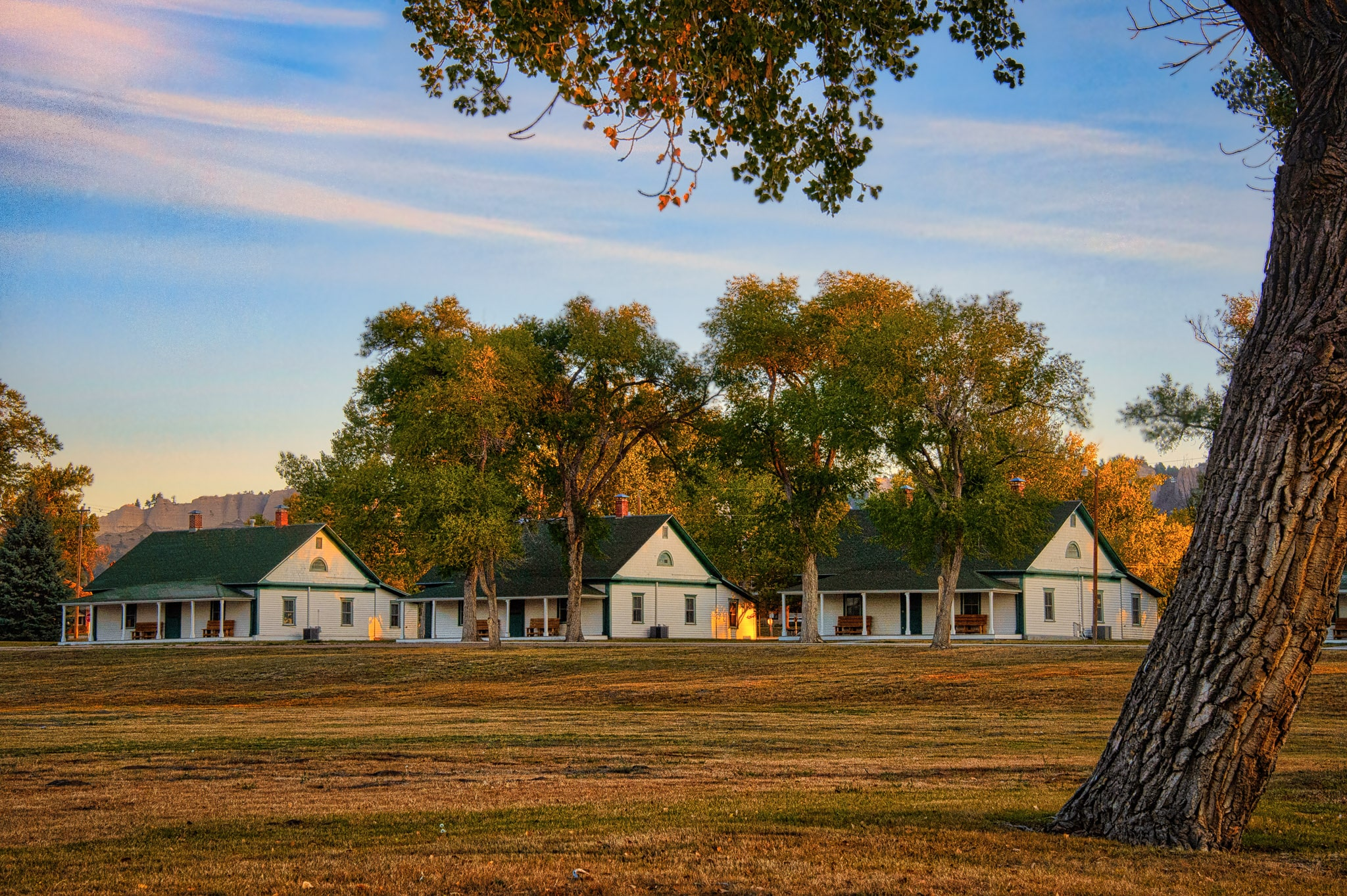 These clapboard cabins line one of the streets in Fort Robinson State Park. In the foreground is an ancient Cottonwood tree.