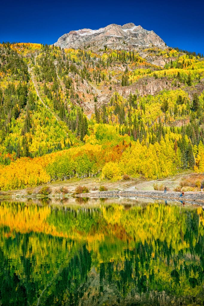 Aspens and oaks are flected in Crystal Lake near Ironton, Colorado, off US 550.