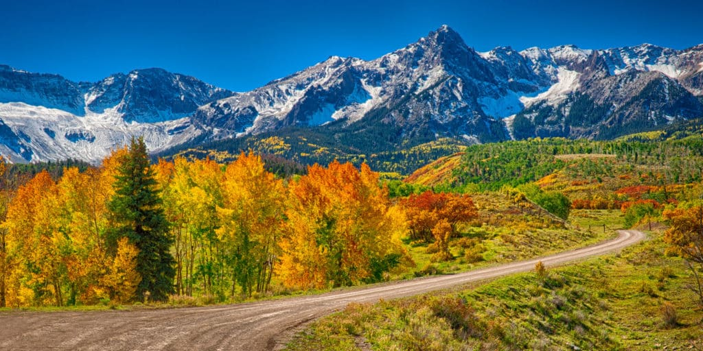 CR 9 near Ridgway, Colorado, winds through the foothills of Mt. Sneffels through aspens and gambel oaks near Ridgway, Colorado.