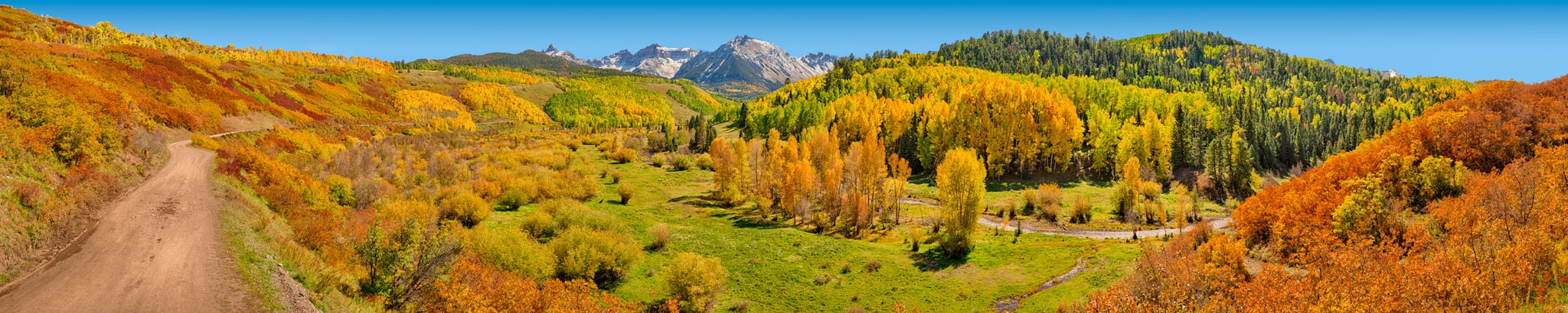 A panoramic view along CR 7, looking toward the Snellels Wilderness showing the autumn colors of aspen, gambel oak, and cottonwoods