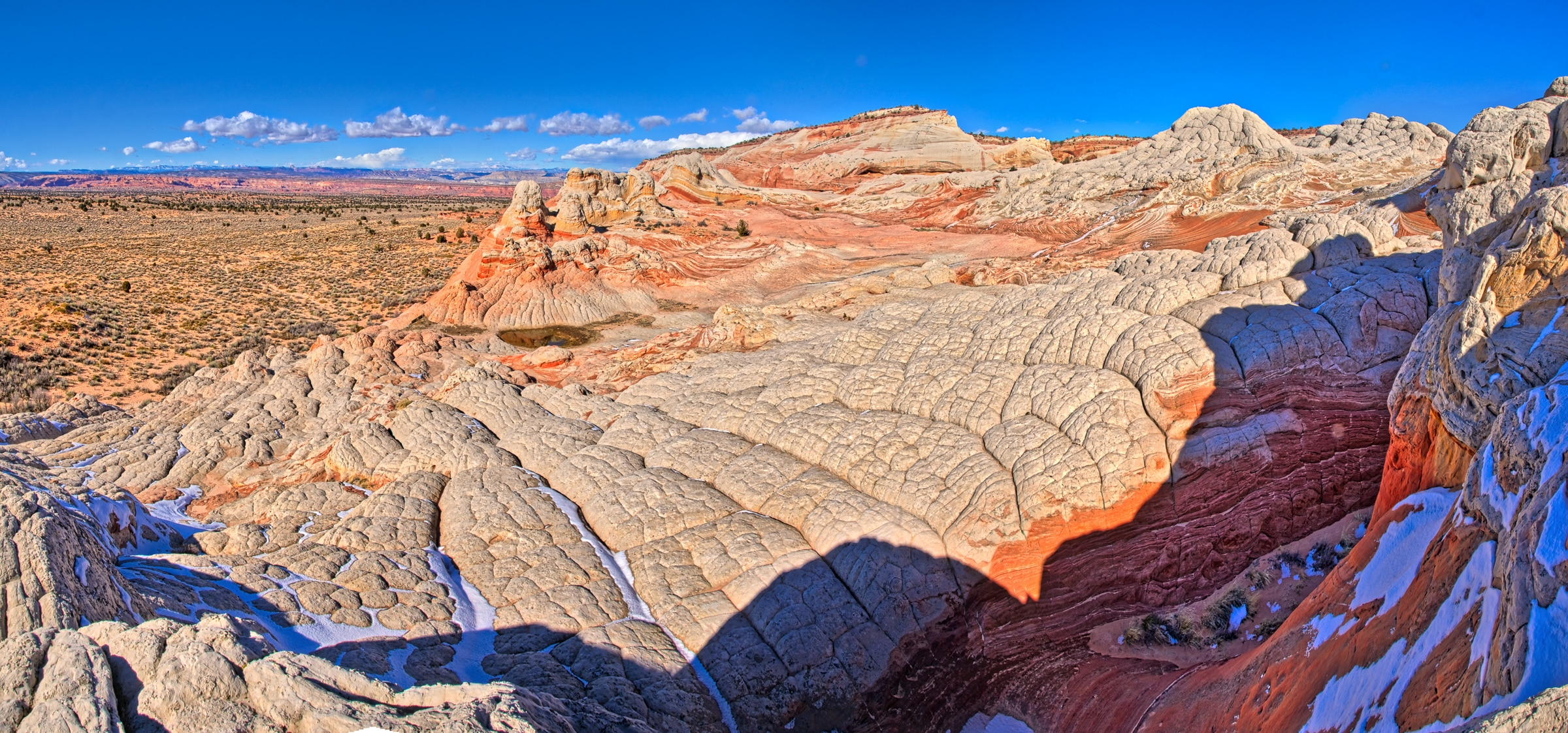This panoramic view shows the Navajo Sandstone brain rock and the brilliant red swirls in Vermillion Cliffs National Monument.