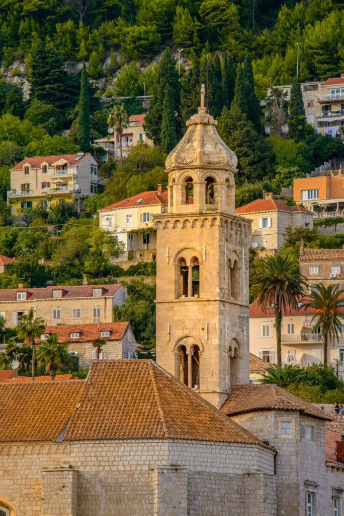 The bell tower of the Dominican Church and Monastery as seen from the wall surrounding Dubrovnik Old City in Croatia.