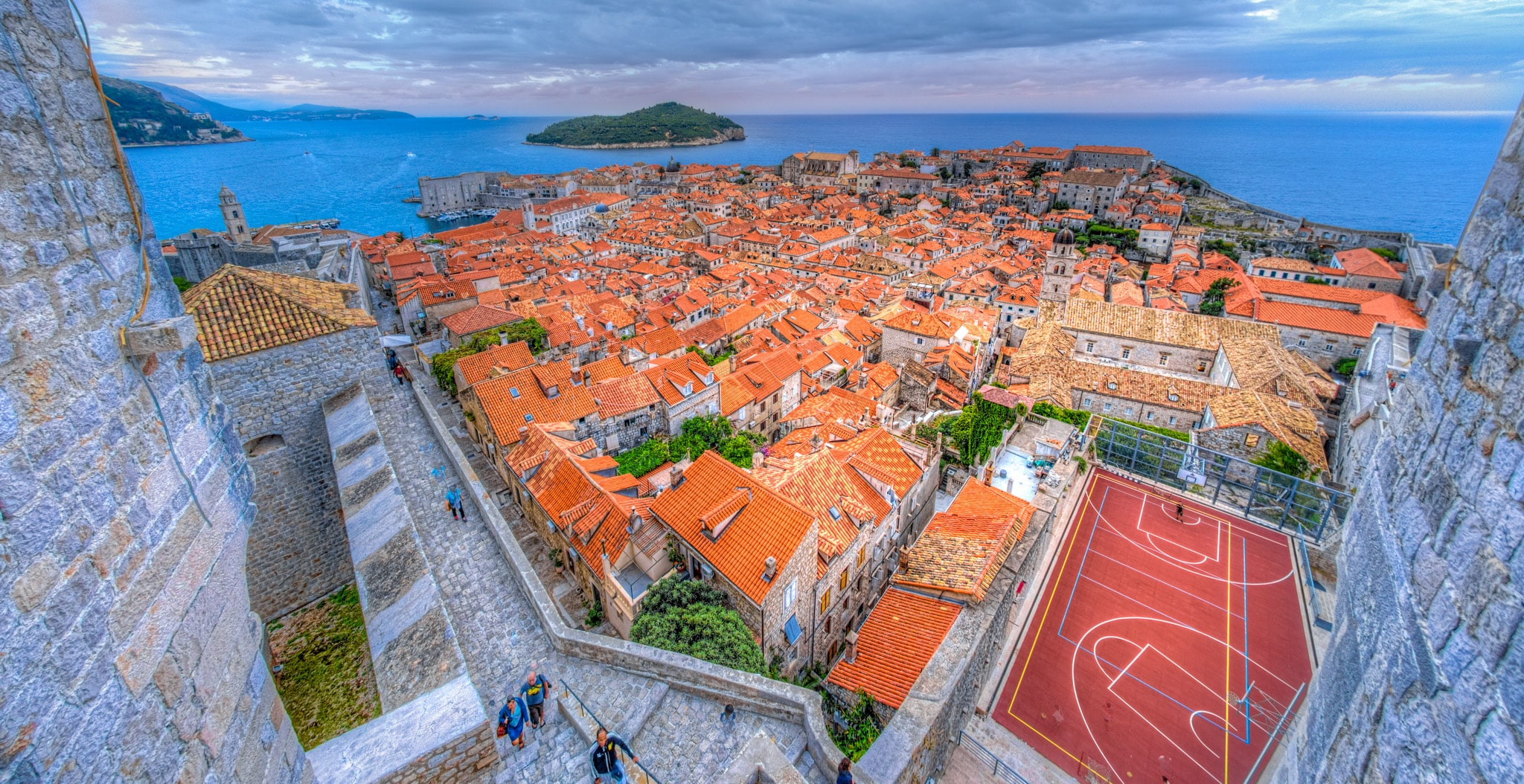 Looking across Dubrovnik Old Town from the Minceta Tower to the island of Lokrum with a soccer/basketball court in the foreground.