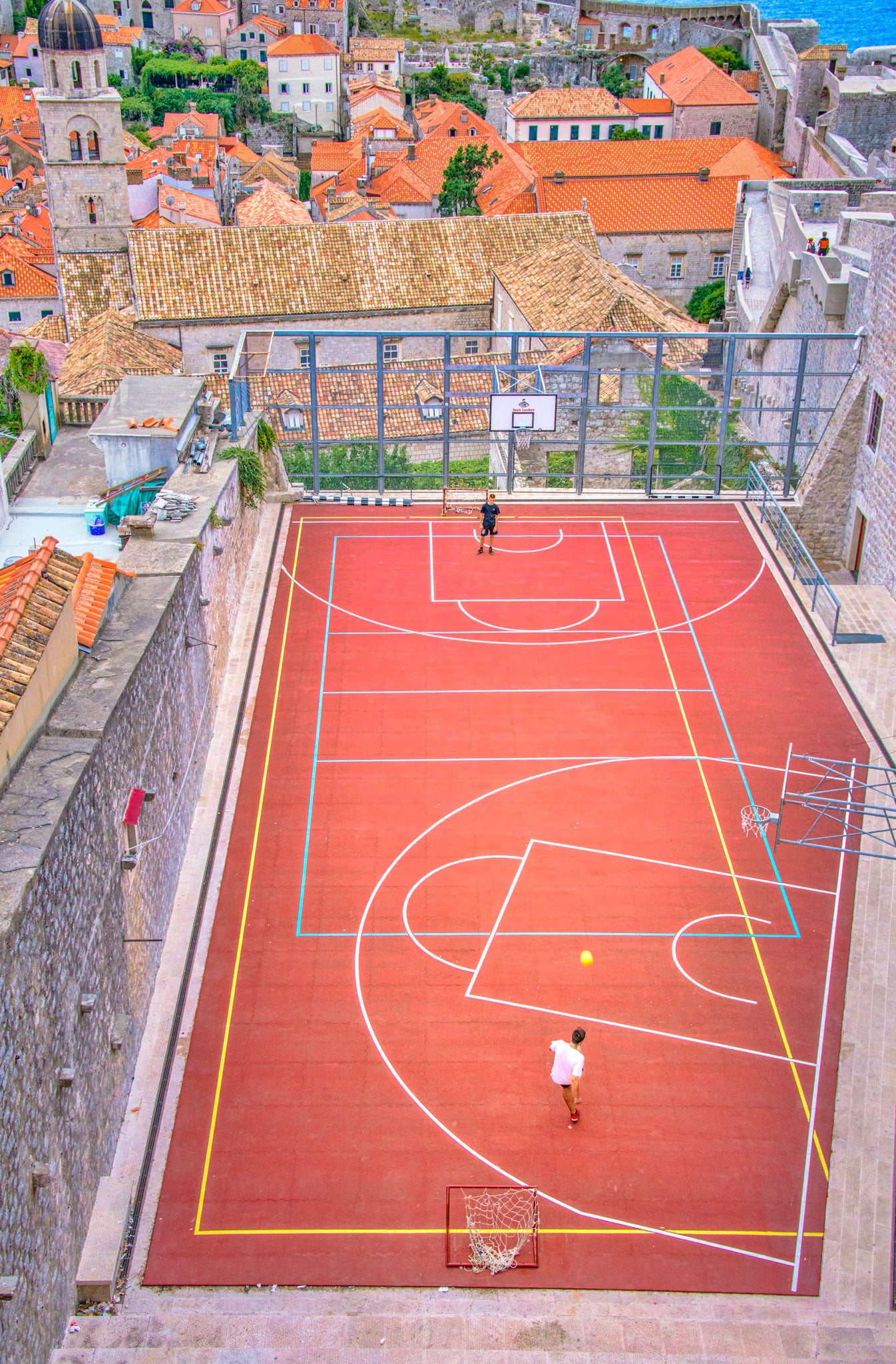 A view of a soccer/basketball court within Dubrovnik Old Town as seen from the Monceta Tower in the city wall.