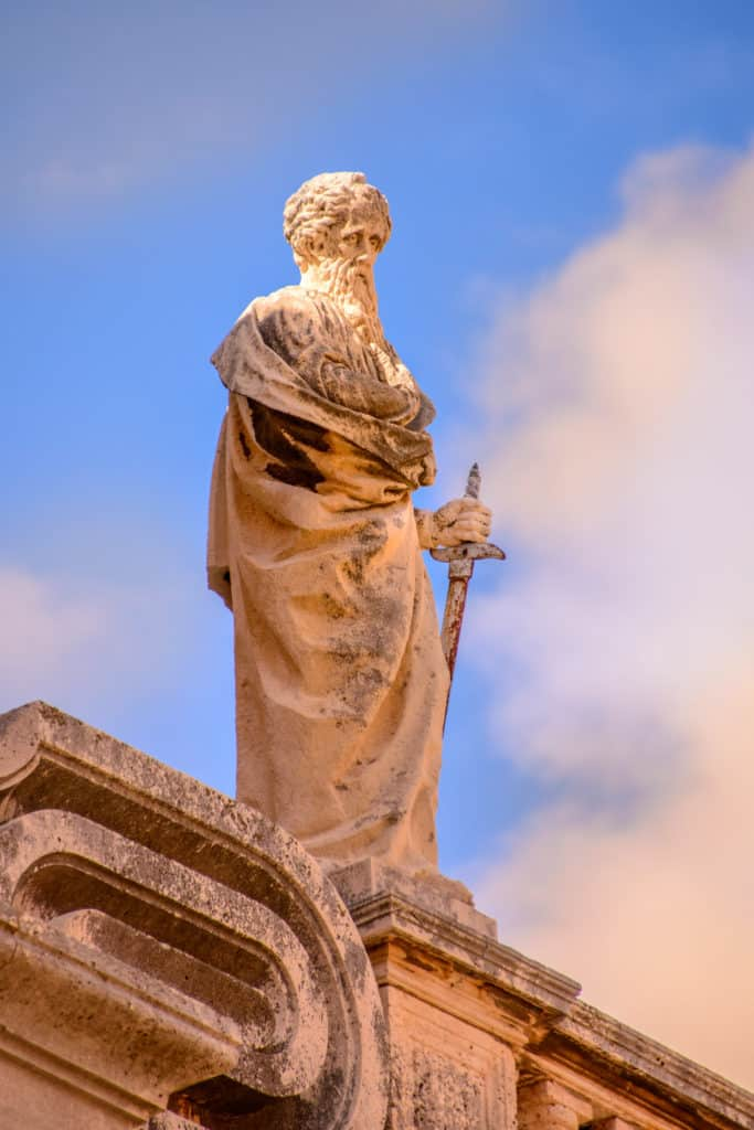 A close-up of one of the many statues that adorn the parapets of the Dubrovnik Cathedral in Dubrovnik Old Town in Croatia.