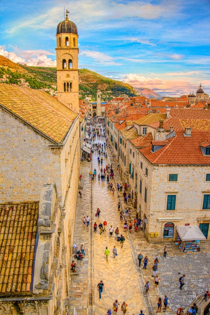 A view from Dubrovnik's city wall looking down the Stradum to the Dubrovnik Clock Tower in the distance and the Franciscan Church bell tower to the left.