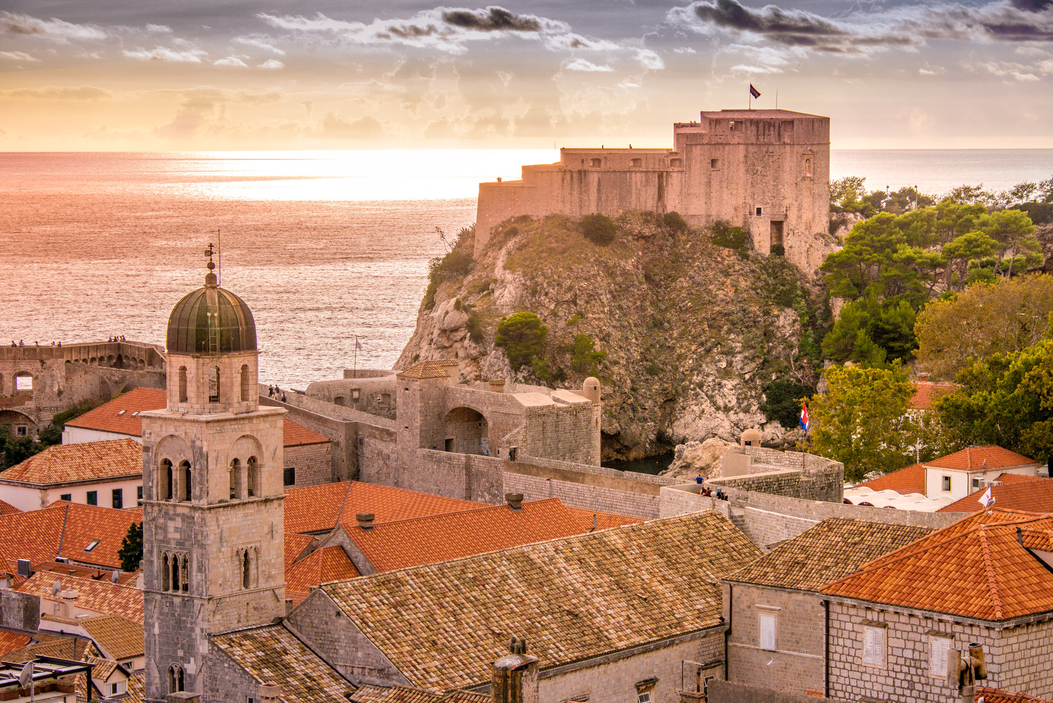 Lovrijenac Fortress and the bell tower of the Franciscan Monastery at sunset as viewed from the Dubrovnik Old Town wall.
