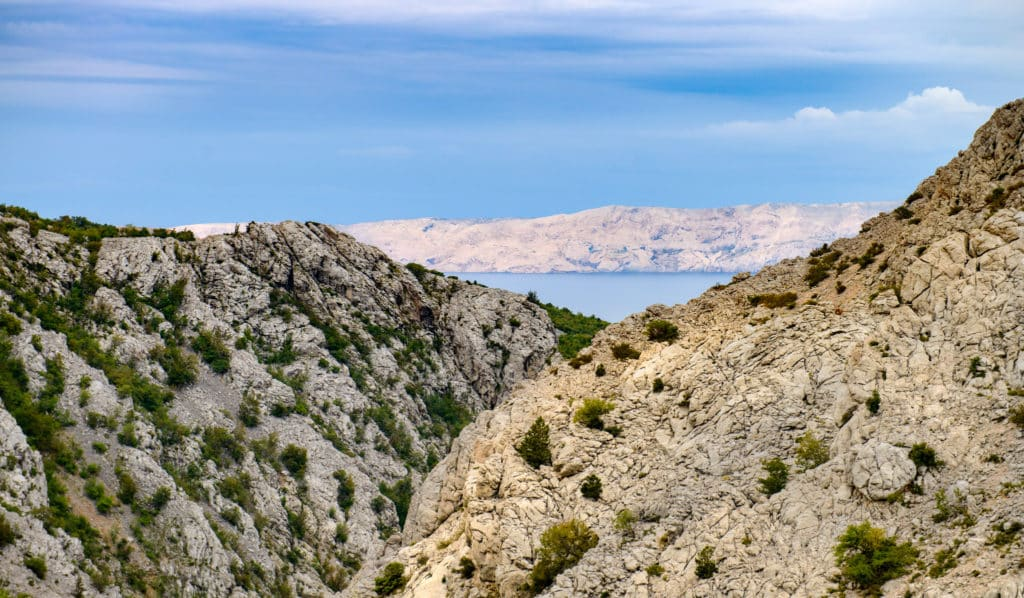 A view of the dolomite and limestone rock formations seen along the coastal road in northern Dalmatia in Croatia.