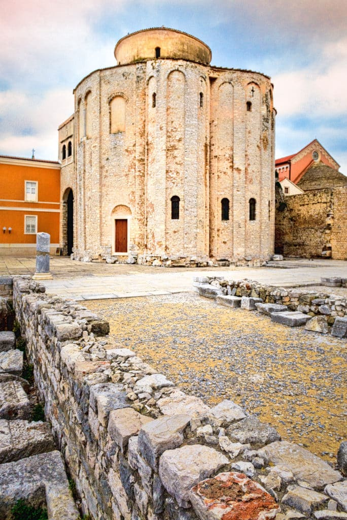 A view of the Romanesque Church of St. Donatus adjacent to remnants of the Roman forum in the Illyrian city of Zadar in Croatia.