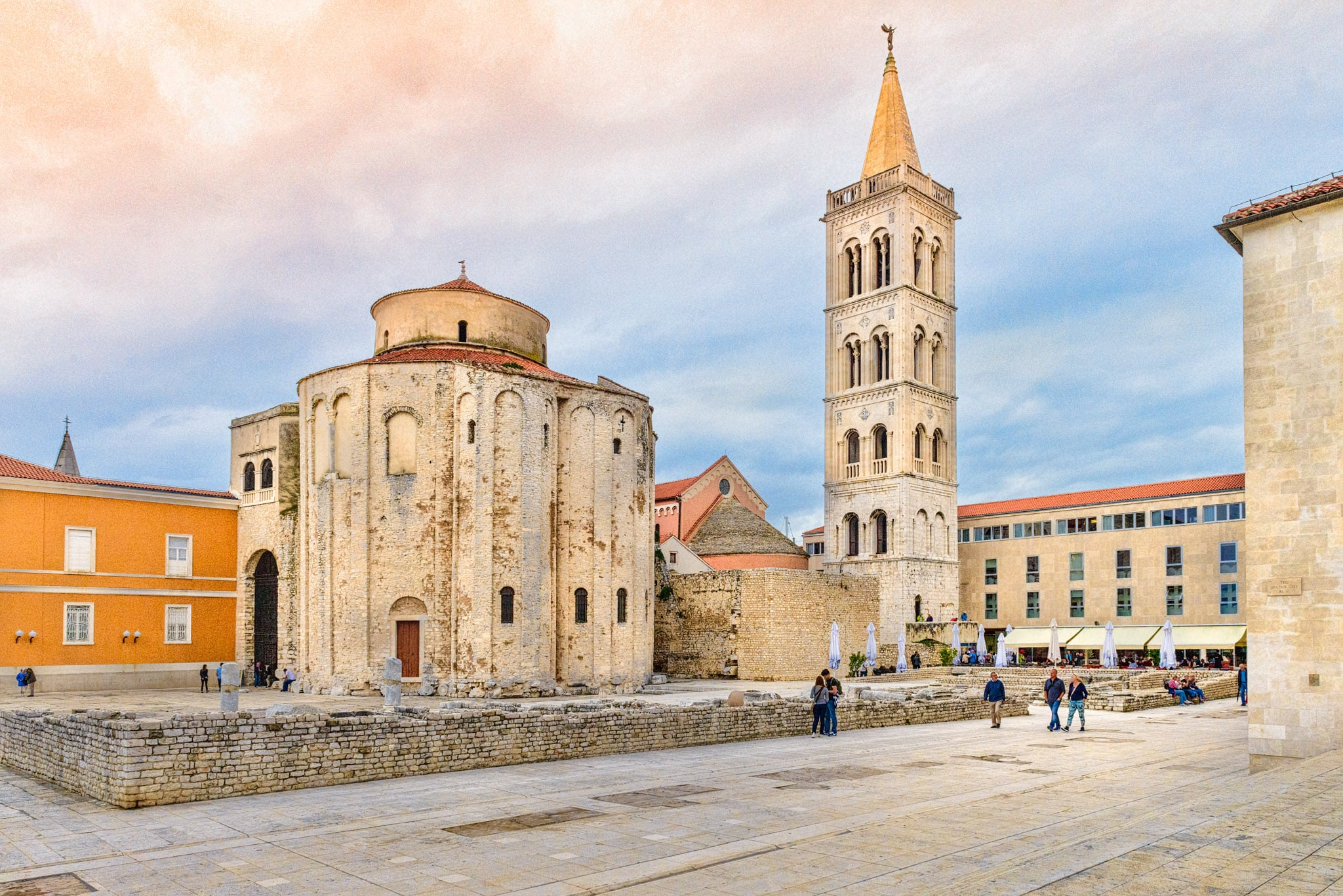 A view of the Romanesque Church of St. Donatus and the bell tower of the Cathedral of St. Anastasia adjacent to remnants of the Roman forum in the Illyrian city of Zadar in Croatia.
