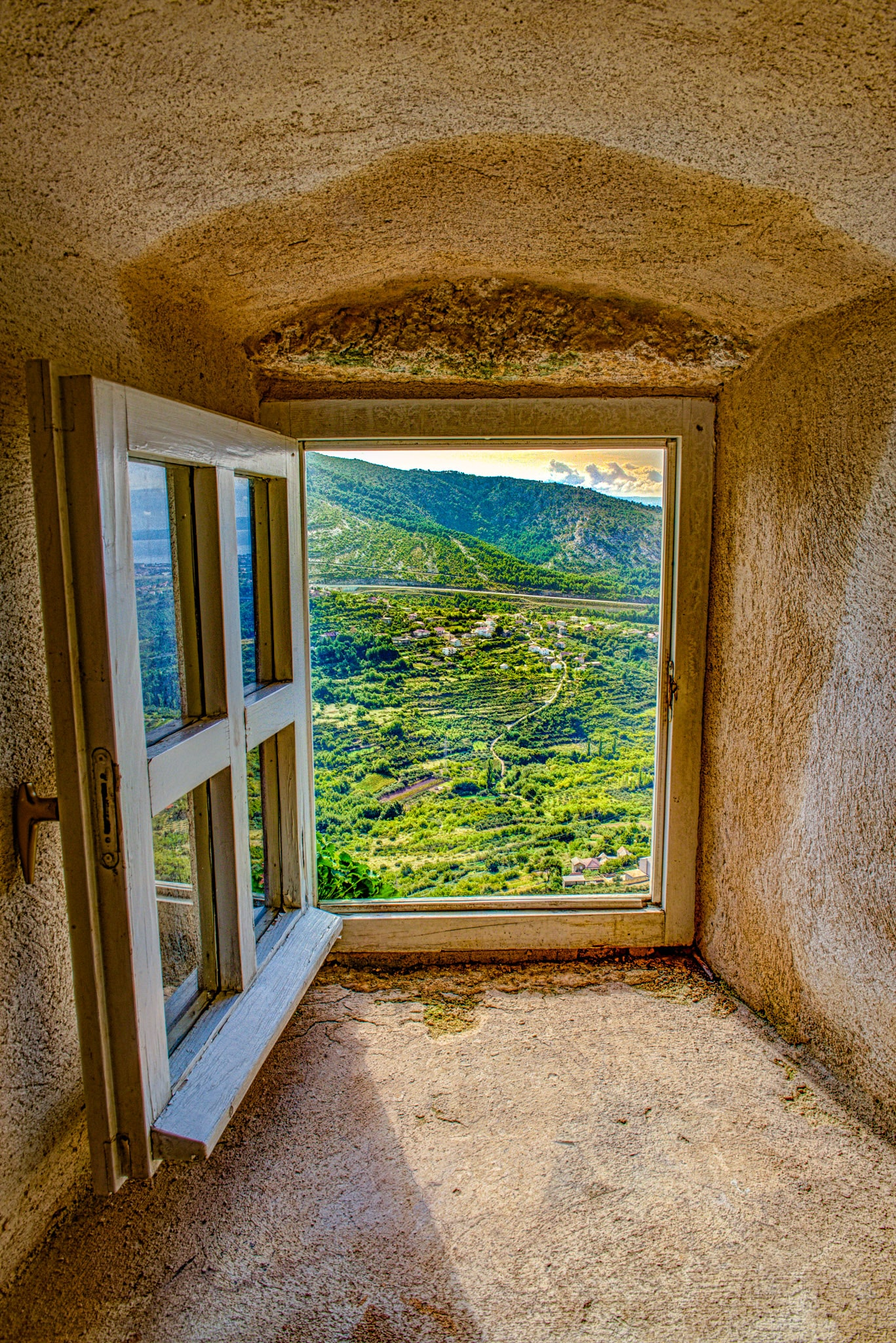A view of the country side as seen through a window in the House of Dux of Klis Fortress near the Croatian city of Split.