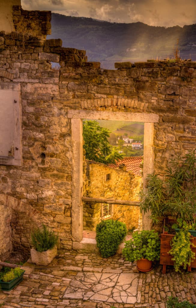Looking through a doorway in a ruined building in the Medieval Istrian village of Motovun, Croatia.