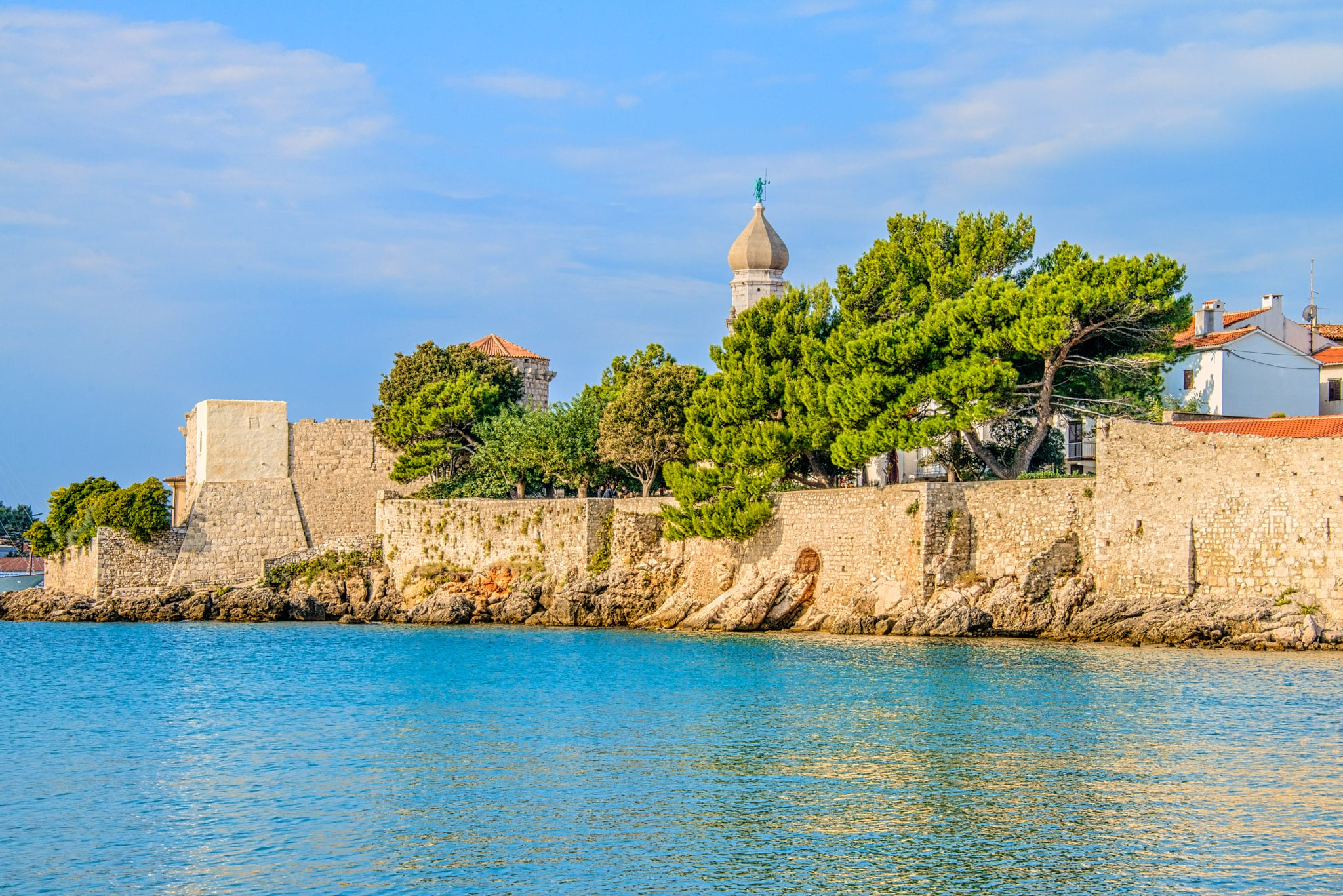 A view of the city walls and Krk Cathedral in Krk, Croatia.