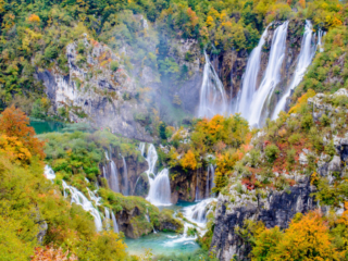 The Big Waterfall, also known as Veliki Slap, surrounded by autumn leaves as seen from just inside Entrance 1 of Plitvice Lakes National Park in Croatia.