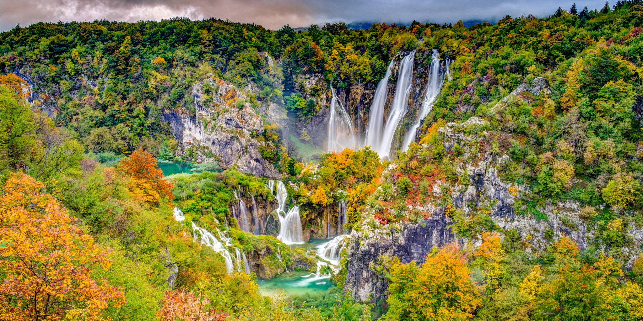 The Big Waterfall, also known as Veliki Slap, surrounded by autumn leaves as seen from just inside Entrance 1 of Plitvice Lakes National Park in Croatia