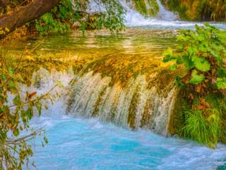 Stair-step falls run between Lakes Gavanovac and Kaluderovac in Plitvice Lakes National Park in Croatia.