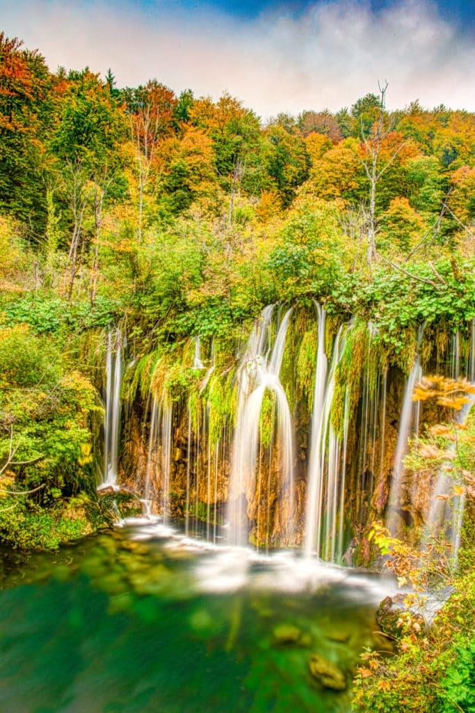 Waterfalls tumble into Lake Kozjak in Plitvice Lakes National Park in Croatia.
