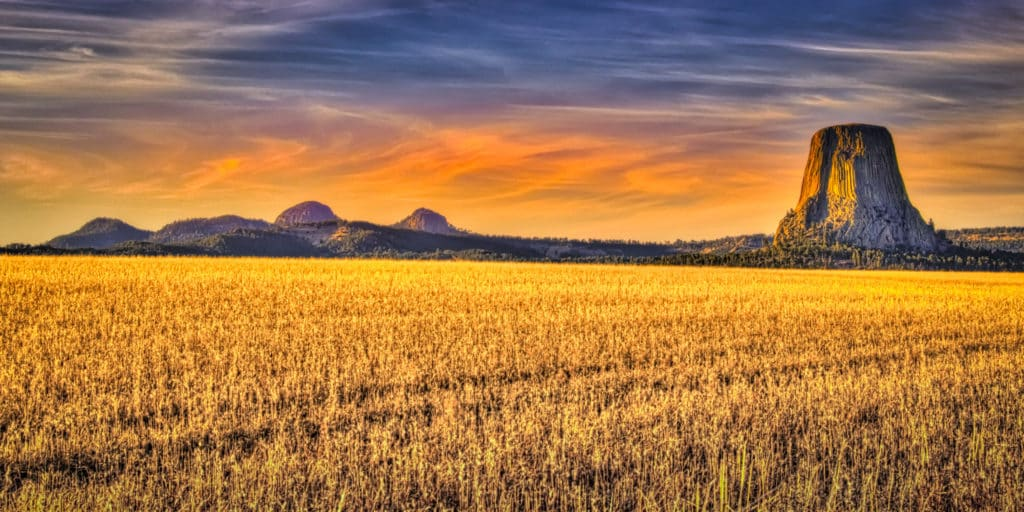 A view of Devils Tower from a field north of the National Monument.