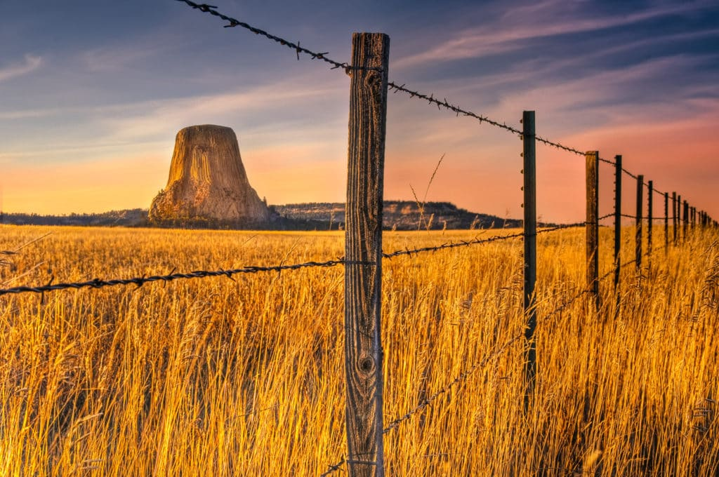 A view of Devils Tower from a field north of the National Monument