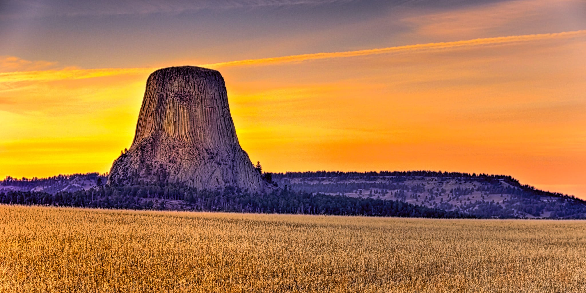 A view of Devils Tower from the north at sunset.