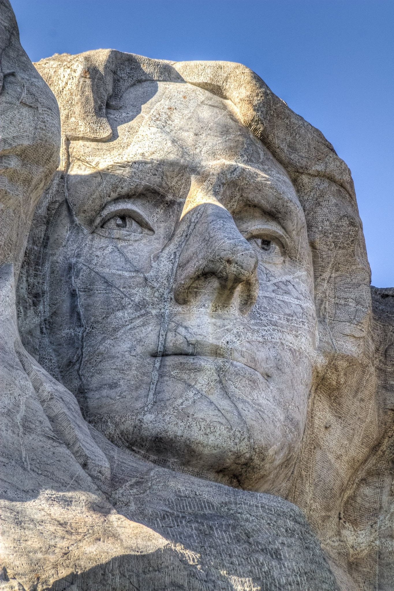 A close-up of the face of President Thomas Jefferson carved into Mt. Rushmore.