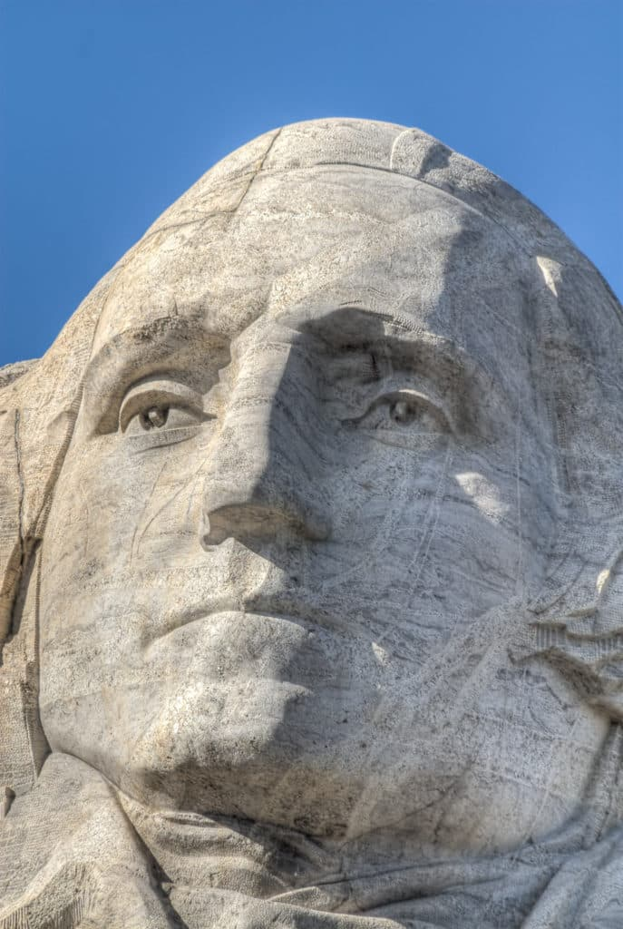 A close-up of the face of President George Washington carved into Mt. Rushmore.