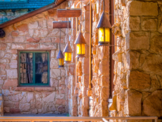 Back wall of the lodge at the North Rim of the Grand Canyon, with hanging lanterns. - Grand Canyon North Rim