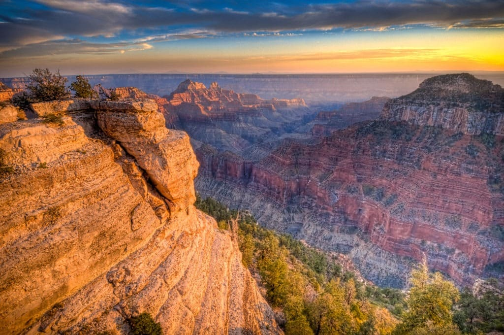 The last rays of sunlight light up the tops of Brahma and Zoraster Temples  on the North Rim of the Grand Canyon. - Grand Canyon North Rim