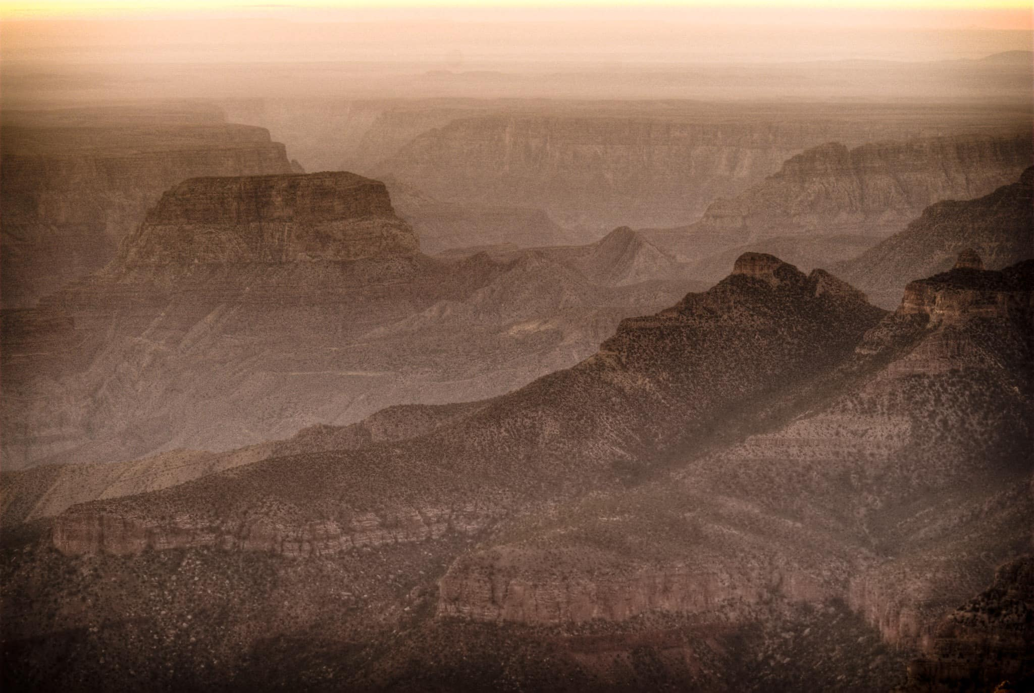 Woolsey Butte and Bourke Point at dawn as viewed from Point Imperial on the North Rim of the Grand Canyon. -  Grand Canyon North Rim