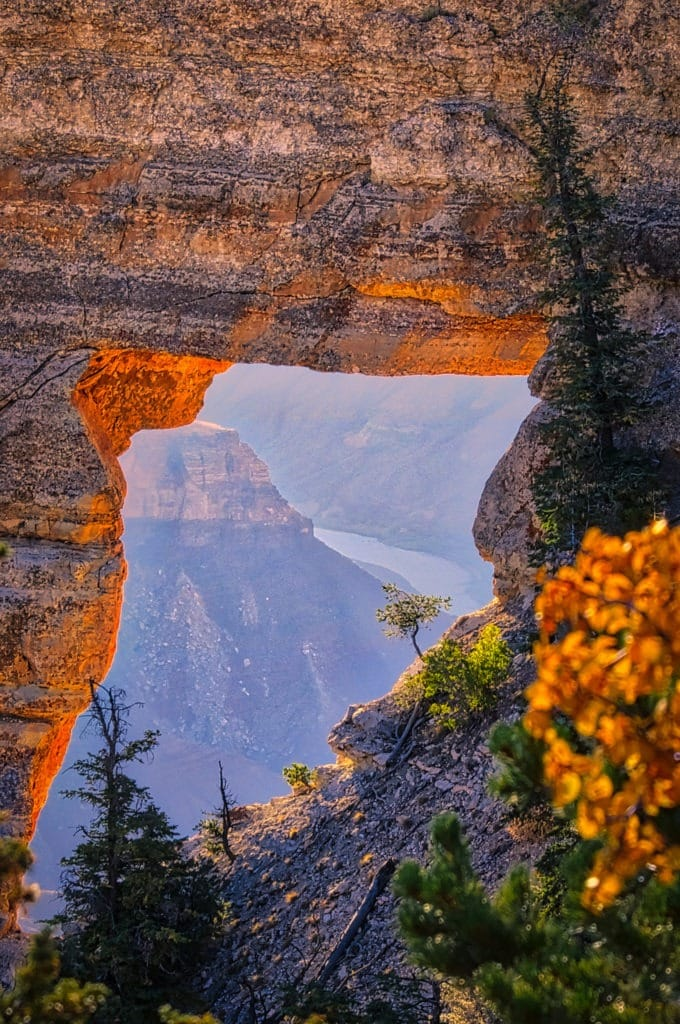 This is a closeup of Angels Window from just north of Cape Royal on the North Rim of the Grand Canyon. Notice the Colorado River. - Grand Canyon North Rim