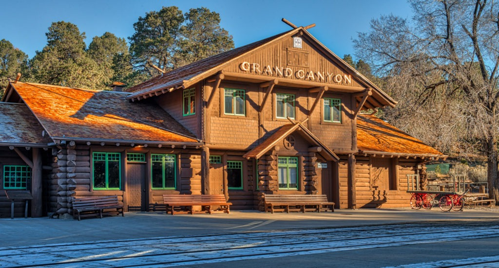 An early morning view of the front of the train station located in Grand Canyon Village on the South Rim of the Grand Canyon in Arizona.