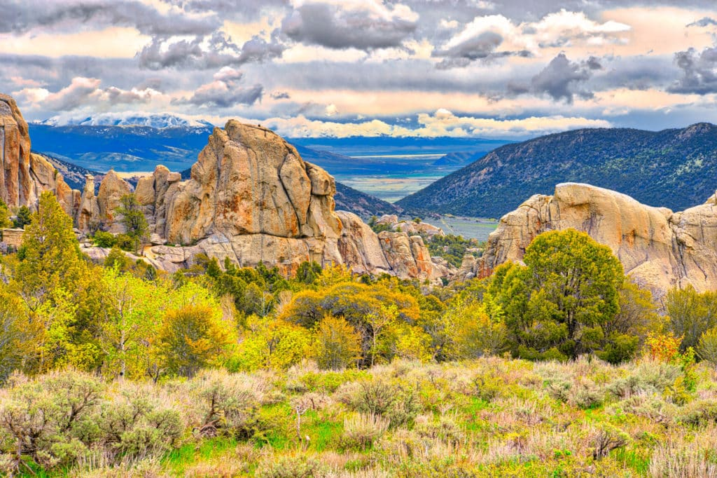 Snow and rain clouds roll over the Albion Mountains approaching the granite formation in City of Rocks National Reserve, near Almo, Idaho.