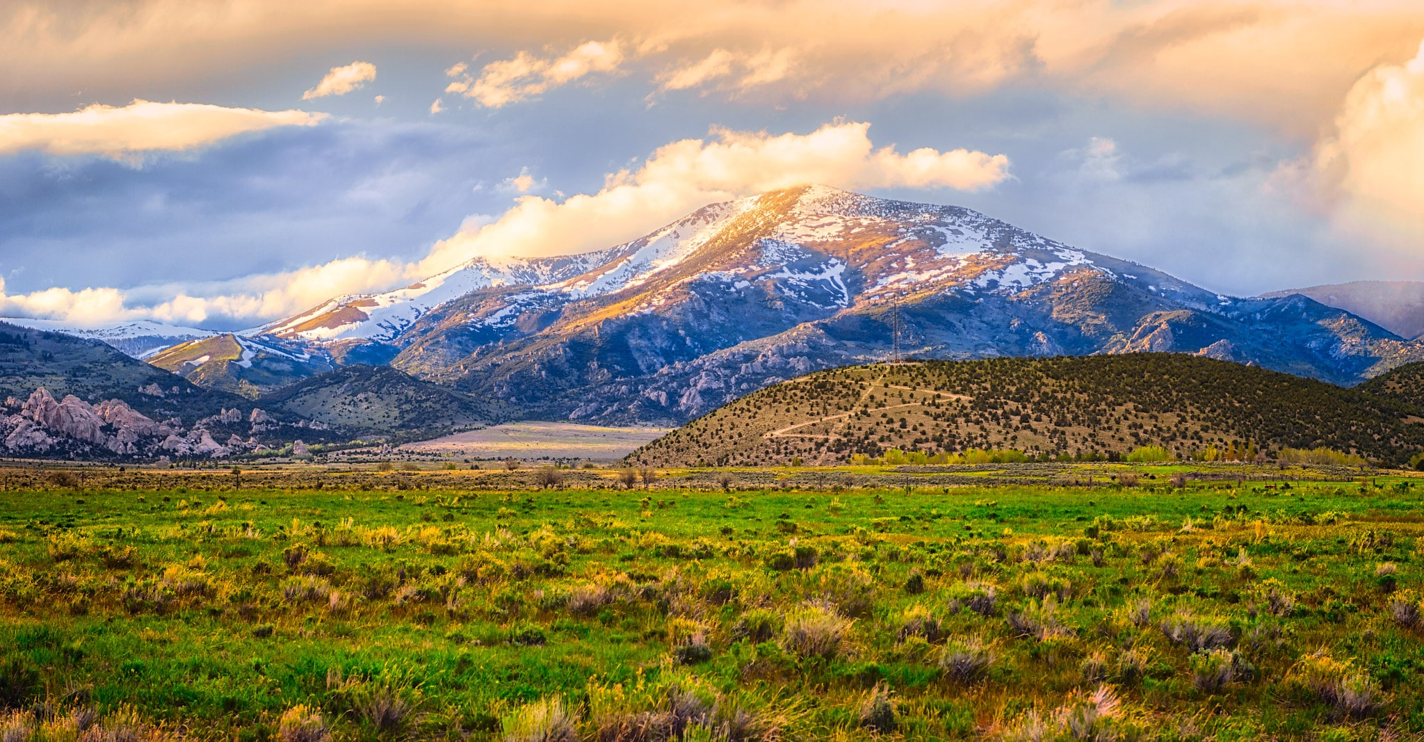 Snow clouds roll down the mountains into City of Rocks National Reserve at sunset, near Almo, Idaho.