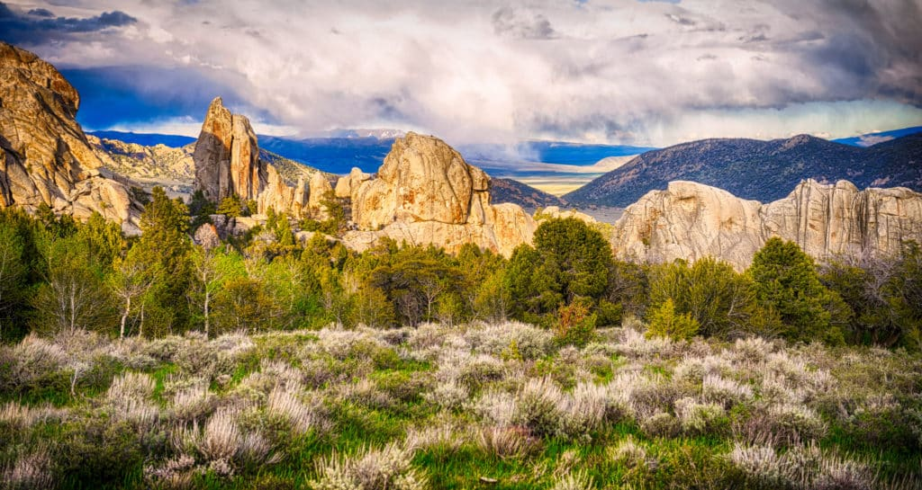 Snow clouds retreat from City of Rocks National Reserve at sunset, near Almo, Idaho.