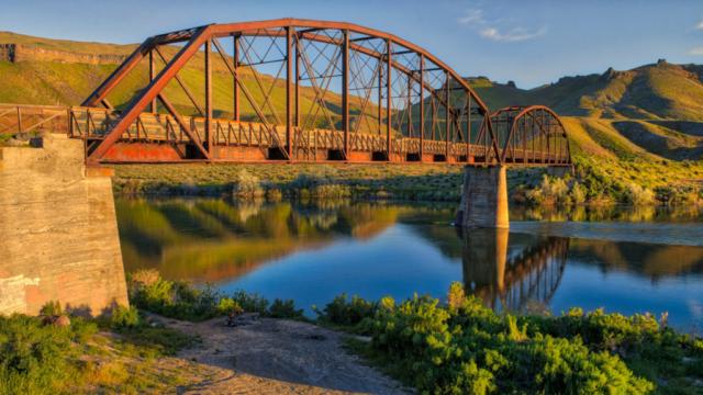 Guffey Bridge is a Parker-Through-Truss Railroad Bridge that is now used as a footbridge across the Snake River in Celebration Park near Melba, Idaho. From my Southwest Idaho Photographs.