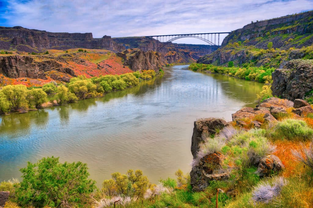 The Perrine Bridge is a truss arch bridge that spans the Snake River Canyon on US Highway 93 in Twin Falls, Idaho. The bridge is 1,500 feet long and has a pedestrian walkway.