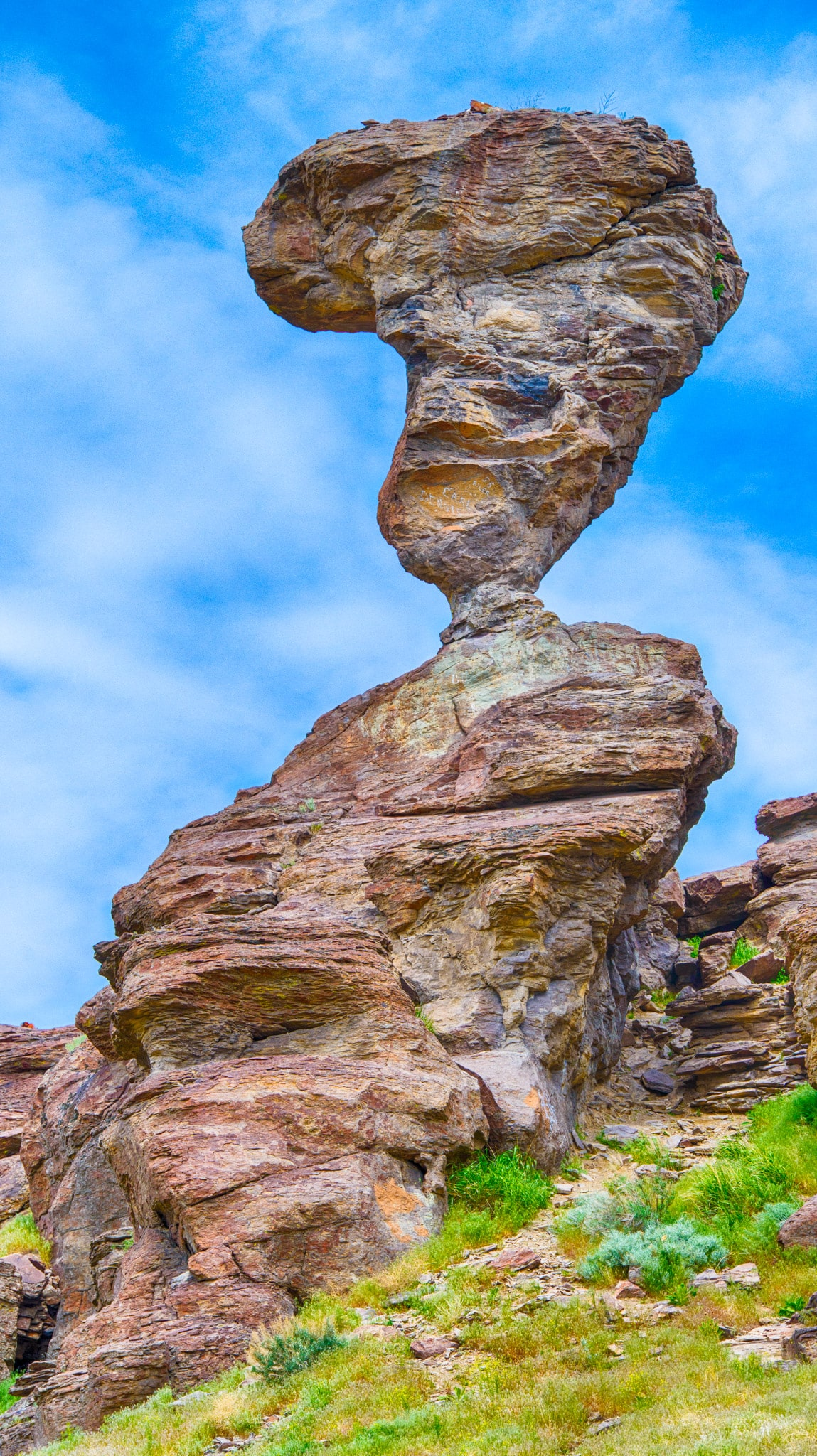 Balanced Rock, located on BLM land near Balanced Rock Park, is a rock formation of wind-carved rhyolite. Because vandals have attempted to topple the rock at various time in the past, the small neck has been reinforced with concrete.