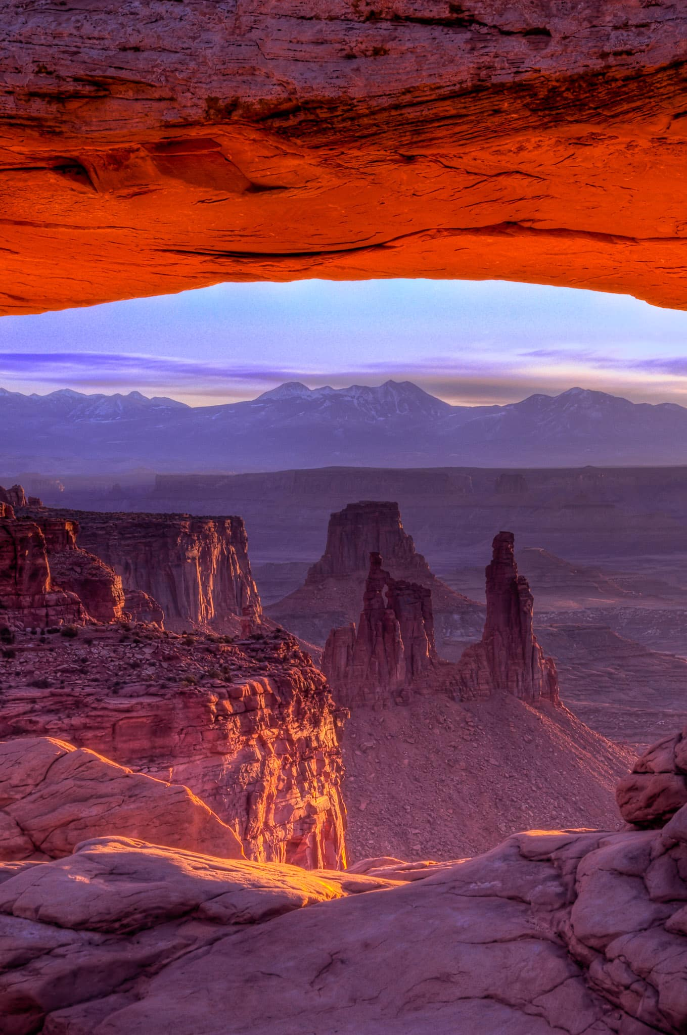 At dawn, looking east through Mesa Arch in Canyonlands National Park.