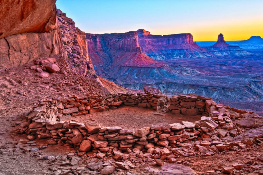 Looking south at sunset from the alcove of False Kiva in Canyonlands National Park, near Moab, Utah.