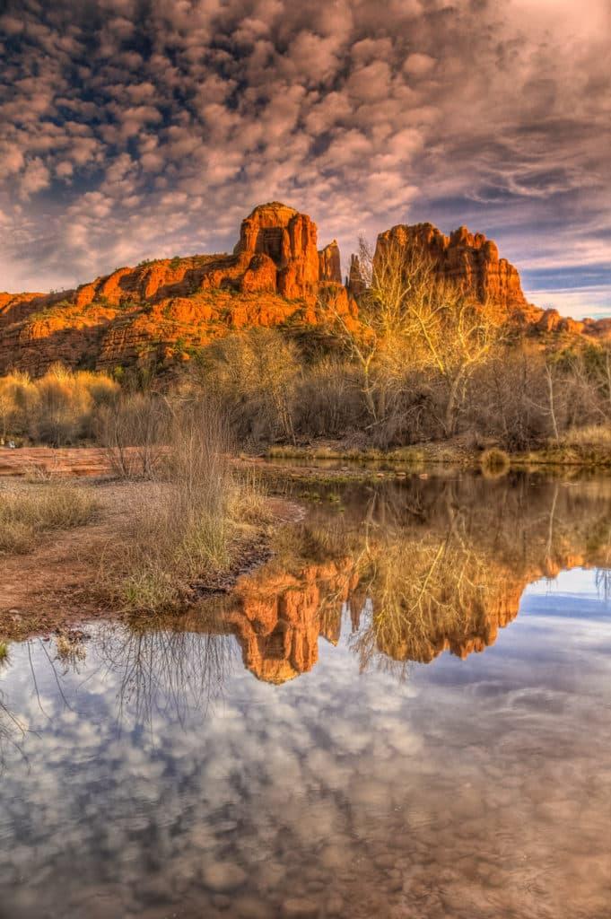 Cathedral Rock reflected in Oak Creek near Red Rock Crossing in Sedona, Arizona.