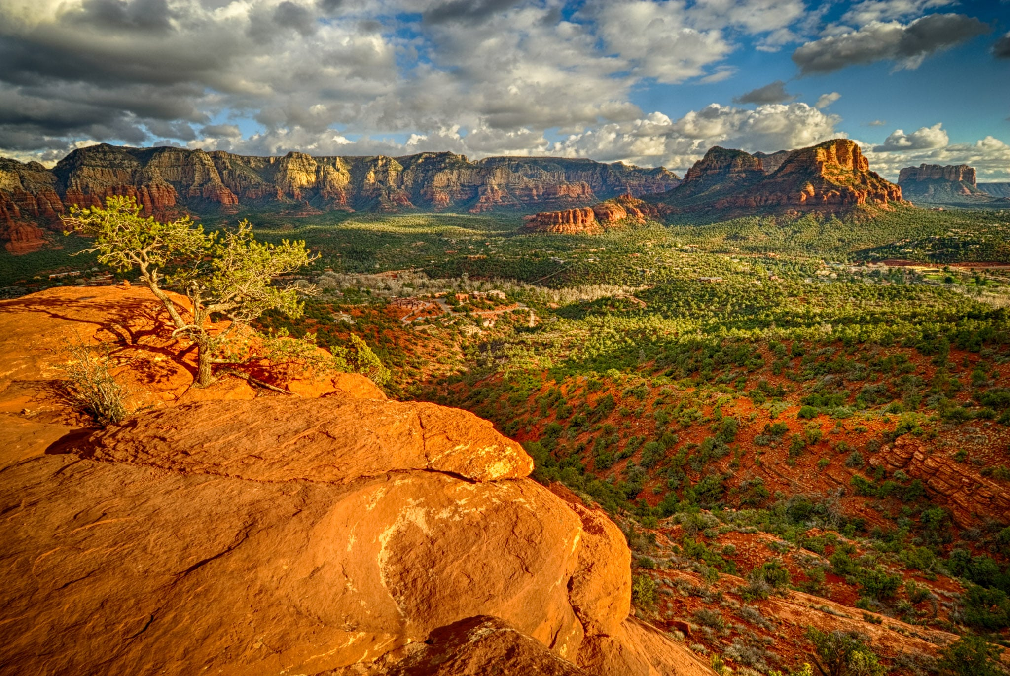 Looking southeast from rock above Airport Road in Sedona, Arizona.Arizona, Sedona, Aorport Road, Twin Buttes, Cathedral Rock, sandstone, sunset, clouds