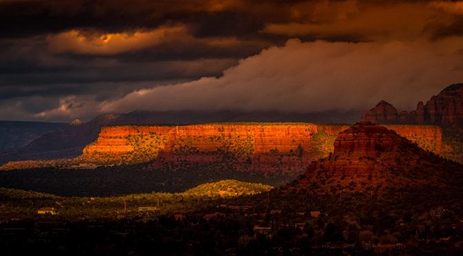 Early-morning sunshine lights up sandstone buttes northwest of Sedona, Arizona.