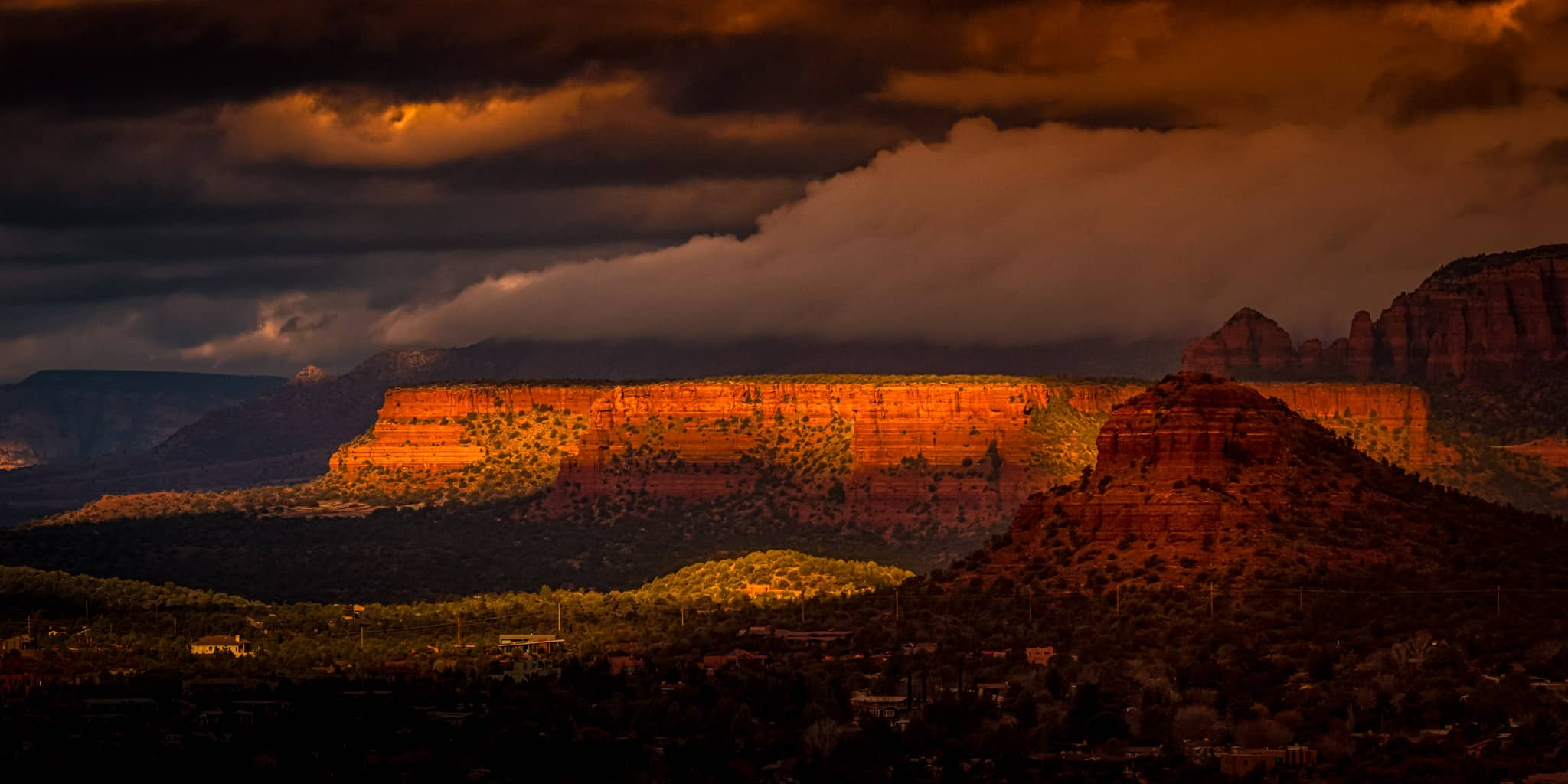 Early-morning sunshine lights up sandstone buttes northwest of Sedona, Arizona.