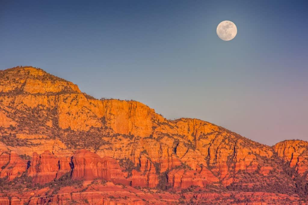 A full moon rises in Sedona, Arizona.